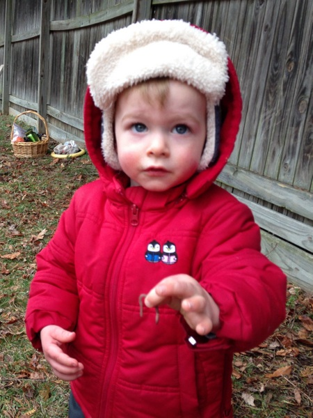 Eastern Ridge School toddler holding worm