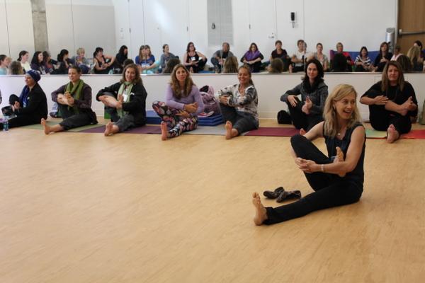 National Kids Yoga Conference Kira Willey cradling leg