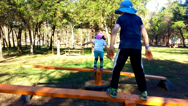 Crunchy-Chewy Mama siblings on teeter totter