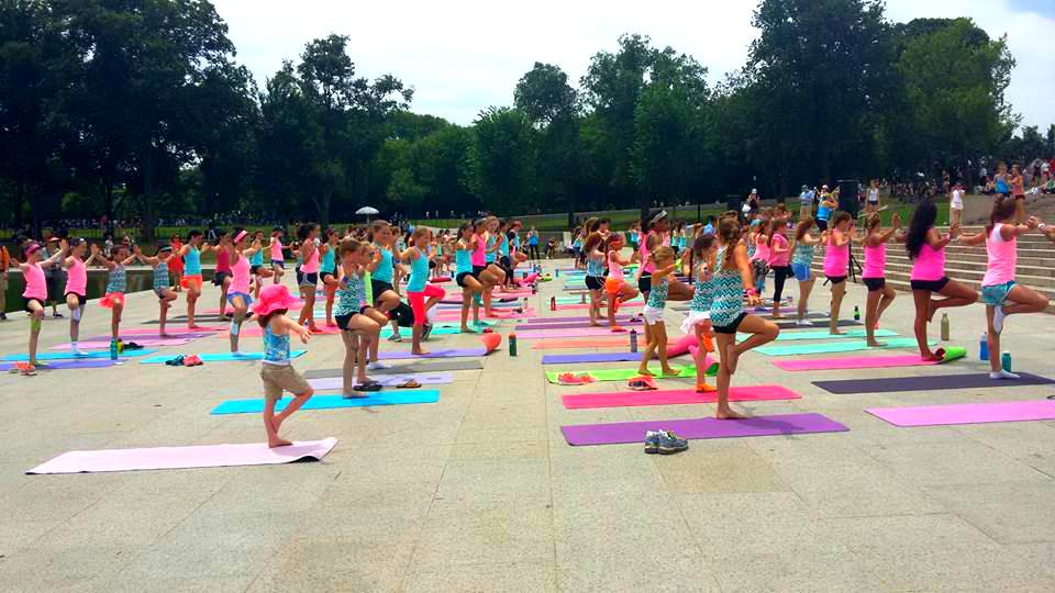 ivivva coasttocoast yoga on the mall tree pose 2