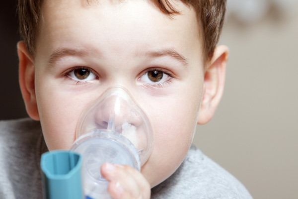 Child with breathing treatment