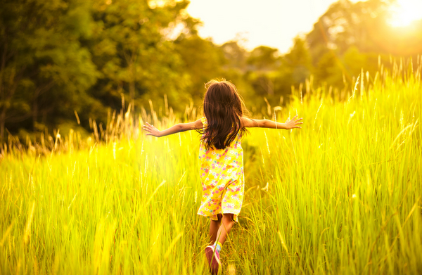 Child running in field - Mindful Healthy Life