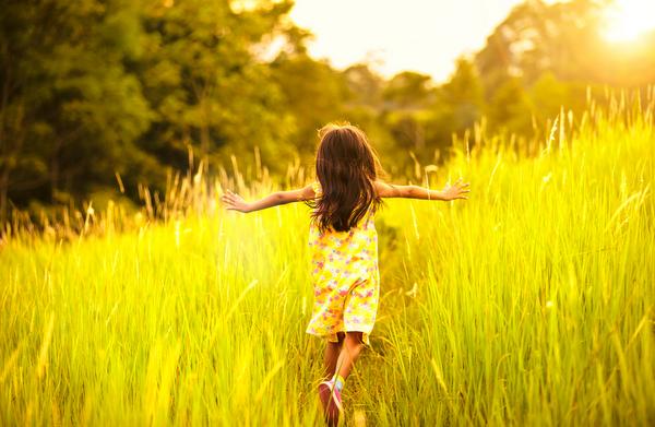 Child running in field