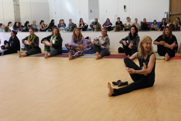 National Kids Yoga Conference Kira Willey cradling leg