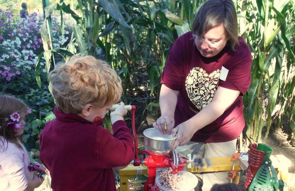 Arcadia Farm griding corn fall festival