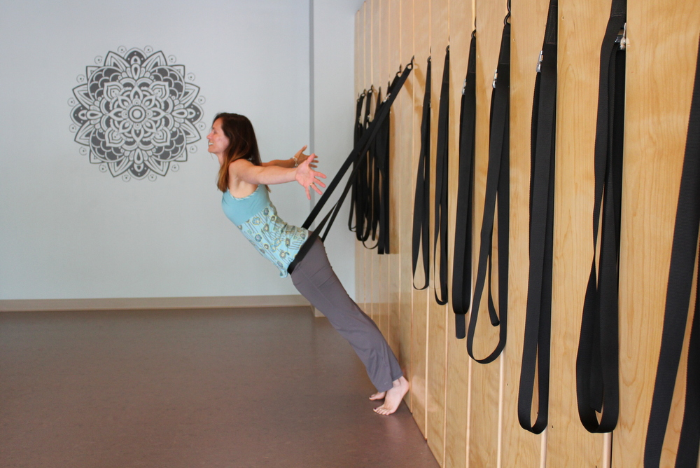 Ease Yoga Cafe by Mindful Healthy Life - owner Tara at wall