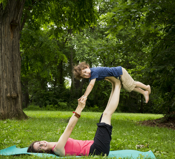 ©Rebecca Emily Drobis ALL RIGHTS RESERVED Teachers and families from Lil Om Studio practice poses outdoors.