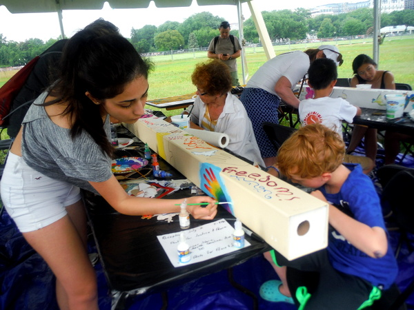 World Children's Festival 2015 - group working on peace pole  - by Mindful Healthy Life