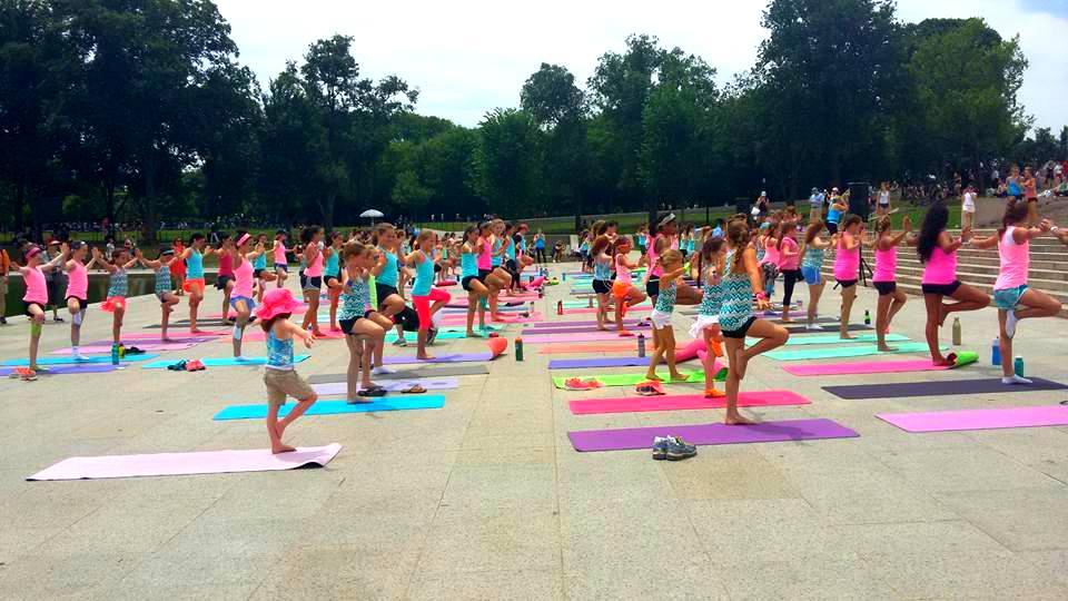ivivva coasttocoast yoga on the mall tree pose 2