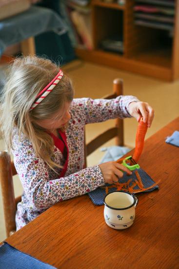 Potomac Crescent Waldorf School peeling carrots