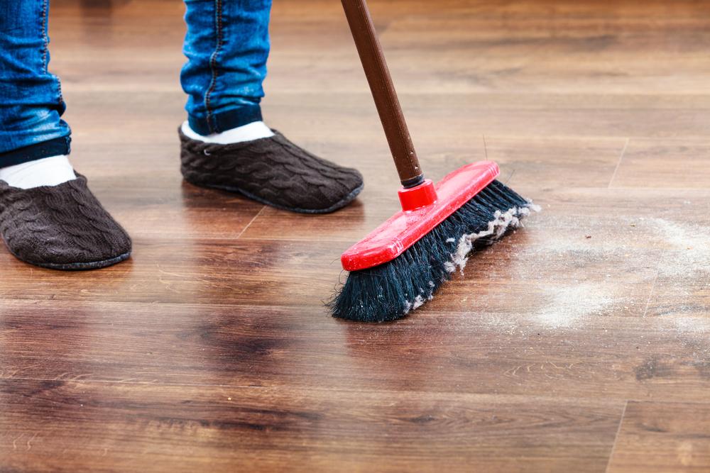 Sweeping wooden floor.